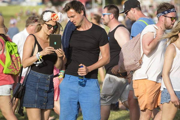 Festival-goers using the EE Glastonbury App